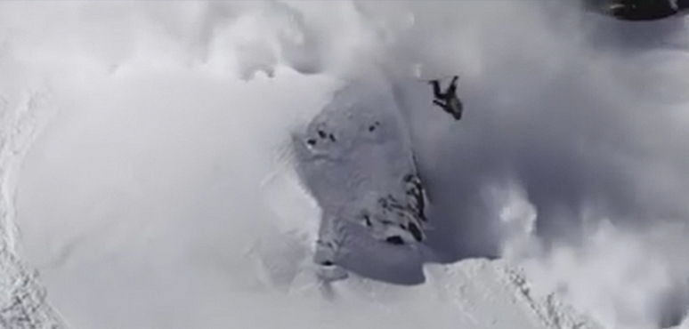 Skier backflips cliff and lands in avalanche and rides away!